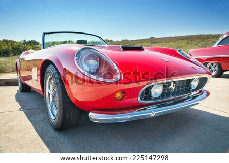 WESTLAKE, TEXAS - OCTOBER 18, 2014: A red 1962 Ferrari 250 GT California Spyder is on display at the 4th Annual Westlake Classic Car Show. Front view. - stock photo