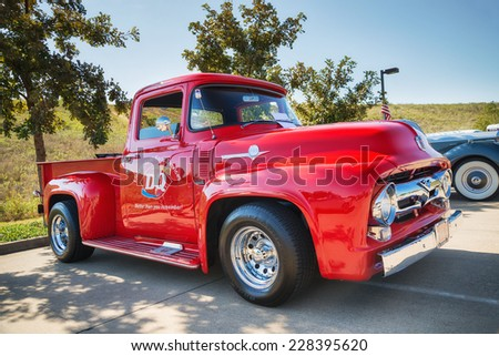 WESTLAKE, TEXAS - OCTOBER 18, 2014: A Red 1956 Ford F-100 Pickup truck classic car is on display at the 4th Annual Westlake Classic Car Show.  - stock photo
