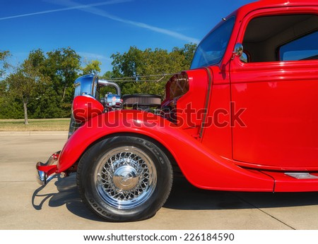 WESTLAKE, TEXAS - OCTOBER 18, 2014: A red 1935 Ford pickup truck is on display at the 4th Annual Westlake Classic Car Show. Closeup of front side.  - stock photo