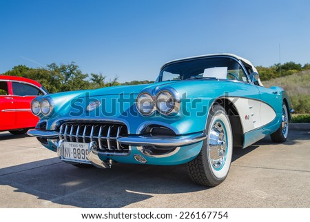 WESTLAKE, TEXAS - OCTOBER 18, 2014: A turquoise 1959 Chevrolet Corvette Convertible is on display at the 4th Annual Westlake Classic Car Show. Front view. - stock photo