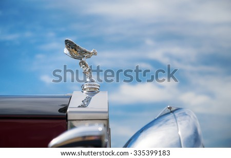 WESTLAKE, TEXAS - OCTOBER 17, 2015: Hood ornament of a 1937 Rolls Royce Park Ward Limousine classic car against blue sky.