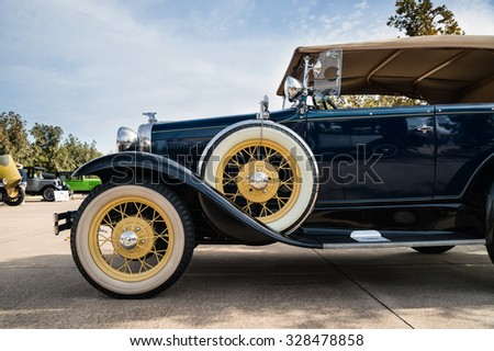 WESTLAKE, TEXAS - OCTOBER 17, 2015: Side view of a 1931 Ford Phaeton Convertible Classic Car.