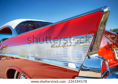 WESTLAKE, TEXAS - OCTOBER 18, 2014: Tail fin and taillight details of a red 1957 Chevrolet Bel Air classic car.  - stock photo
