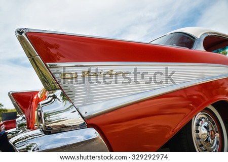 WESTLAKE, TEXAS - OCTOBER 17, 2015: Tail fin and taillight details of a red 1957 Chevrolet Bel Air classic car. - stock photo