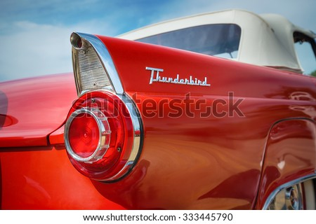 WESTLAKE, TEXAS - OCTOBER 17, 2015: Tail fin and taillight details of a red 1956 Ford Thunderbird Convertible classic car. - stock photo