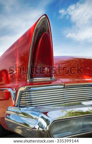 WESTLAKE, TEXAS - OCTOBER 17, 2015: Tail fin and taillight details of a red 1957 Lincoln Premiere classic car. - stock photo