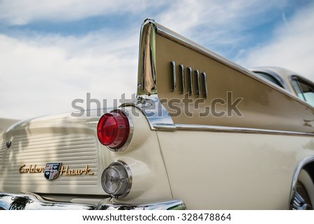 WESTLAKE, TEXAS - OCTOBER 17, 2015: Tail fin and taillight details of a 1957 Studebaker Golden Hawk classic car.  - stock photo