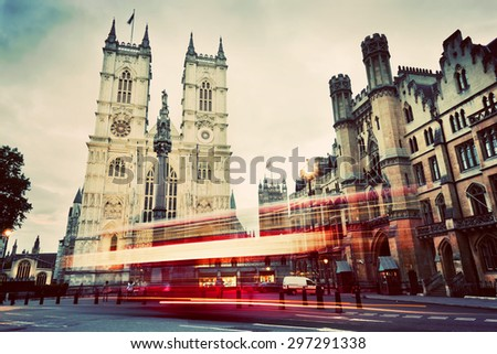 Westminster Abbey church facade, red bus moving in London UK. Symbols of England, Great Britain. Vintage, retro style. - stock photo