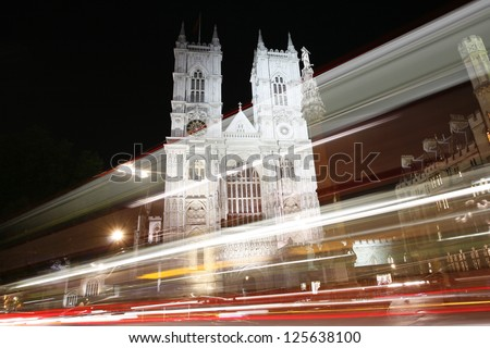 Westminster Abbey, The Great West Door and towers, seen from Tothill Street at night, - stock photo