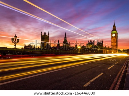 Westminster and a light trail - stock photo