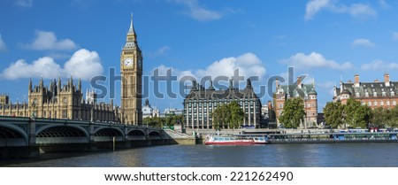 Westminster Bridge and Houses of Parliament with Thames river. - stock photo