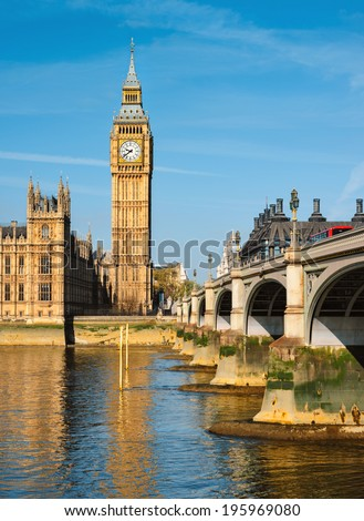 Westminster bridge in London, view towards London Parlamend and Big Ben - stock photo