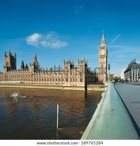 Westminster bridge in London with a view towards London Parlamend and Big Ben, square composition, text space - stock photo