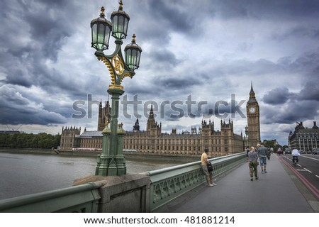 WESTMINSTER BRIDGE, LONDON, ENGLAND-19th AUG 2015:-Westminster bridge leads between the old city of london council offices and the houses of parliament