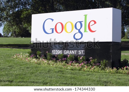 WESTMINSTER, COLORADO/U.S.A.- JULY 9, 2011: Google Corporation entrance sign. Flowers and grass surround the sign, with trees in the background. - stock photo