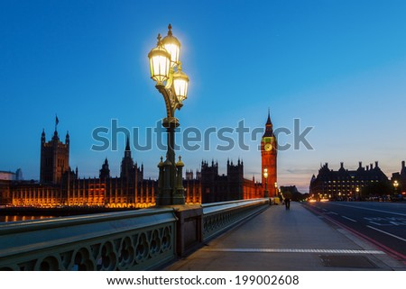Westminster Palace and Big Ben with blue night sky - stock photo