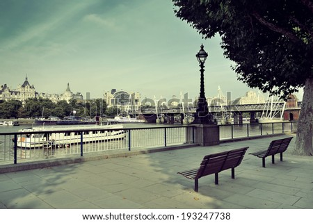 Westminster panorama with chair at waterfront in London.. - stock photo
