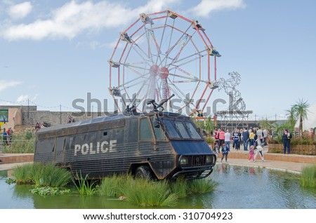 WESTON-SUPER-MARE, UK - AUGUST 26, 2015:  A former crowd control police van with water cannon from Northern Ireland now converted to a fountain.  Weston-Super-Mare.
