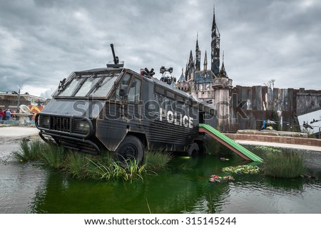 WESTON-SUPER-MARE, UK - SEPTEMBER 3 2015: A police riot van in Water Cannon Creek at Banksy's Dismaland Bemusement Park. A five week show in the seaside town of Weston-Super-Mare.