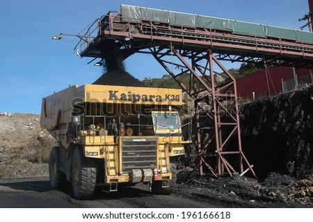 WESTPORT, NEW ZEALAND, CIRCA 2007: Truck loads up with 100 ton of coal at Stockton Coal Mine, West Coast, South Island, New Zealand    - stock photo