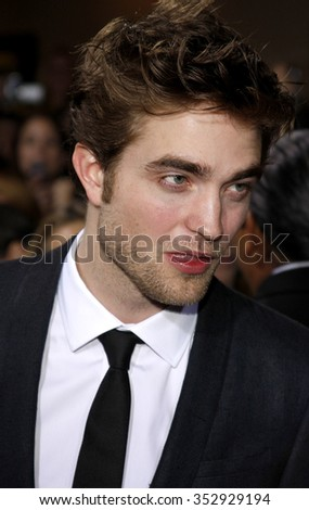 "WESTWOOD, CALIFORNIA - November 16, 2009. Robert Pattinson at the Los Angeles premiere of ""The Twilight Saga: New Moon"" held at the Mann Village Theater, Westwood, Los Angeles."
