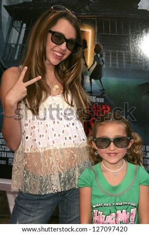 "WESTWOOD - JULY 17: Miley Cyrus and sister at the premiere of ""Monster House"" at Mann Village Theater July 17, 2006 in Westwood, CA."