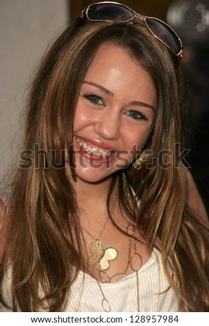 "WESTWOOD - JULY 17: Miley Cyrus at the premiere of ""Monster House"" at Mann Village Theater July 17, 2006 in Westwood, CA. - stock photo"