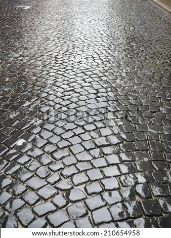 wet ancient cobblestones on oldcity - stock photo