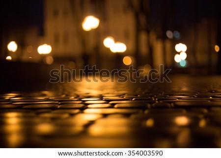 Wet cobblestone street at night. Kharkov. Ukraine - stock photo