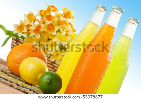 Wet cold beverages with some fruits on table top