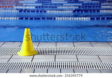 wet floor cone signal in the big Olympic pool - stock photo