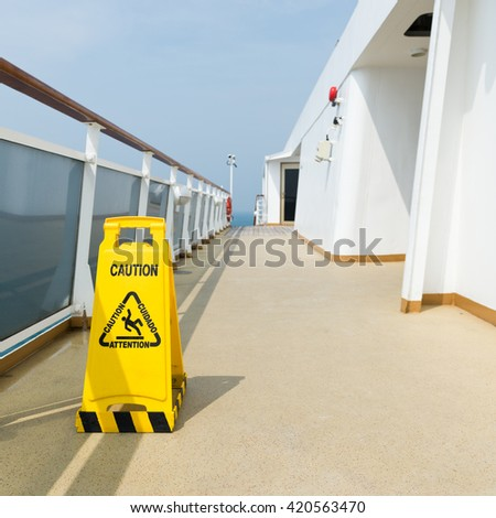 Wet floor sign on deck of cruise ship - stock photo