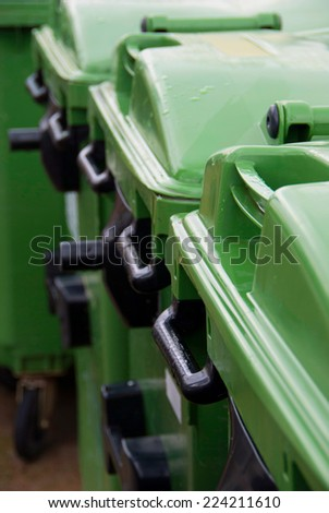 Wet garbage containers in the street. Environment and ecology concept - stock photo