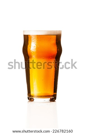 Wet glass of beer - stock photo