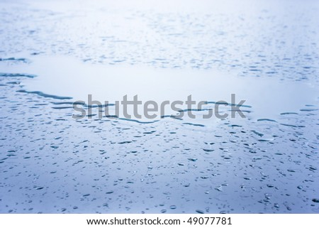 Wet glass surface covered with raindrops. Natural background.