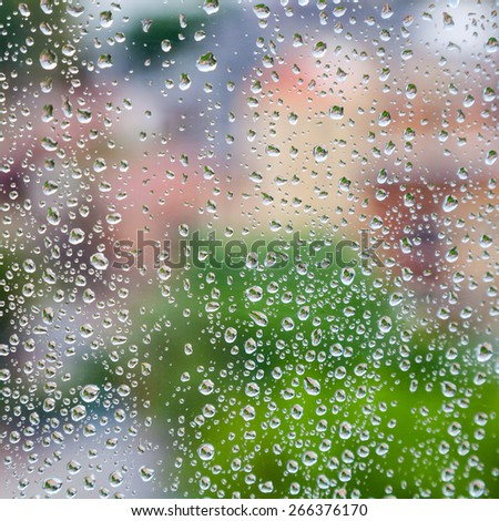 Wet glass with droplets, colorful square photo background with selective focus, and shallow DOF - stock photo