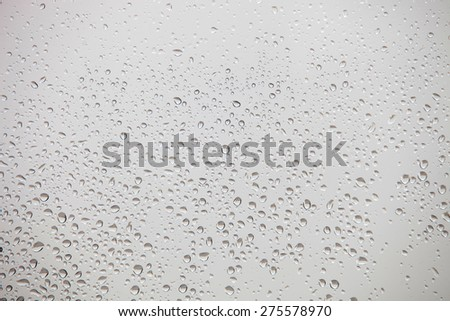 Wet glass with drops of rain fall on the street, - stock photo
