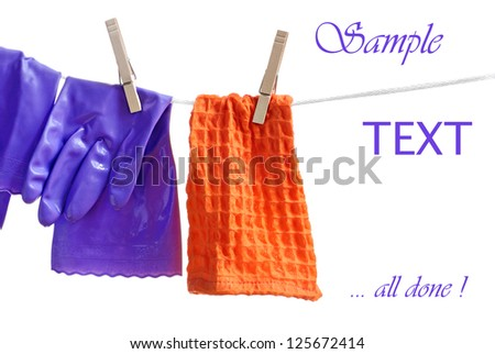 Wet household gloves and cleaning cloth hanging on clothesline to drip dry.  White background with copy space.  Concept - all done with spring cleaning! - stock photo