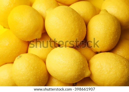Wet lemons as background