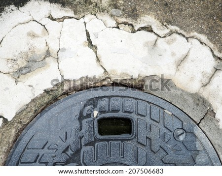 wet manhole cover plate and crack concrete