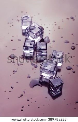 wet melting ice cubes. drink background - stock photo
