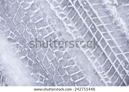 Wet melting snow with tyre marks. - stock photo