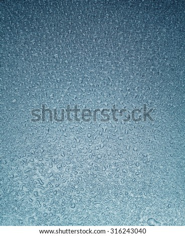 Wet metal surface closeup. Metal texture with water drops. - stock photo