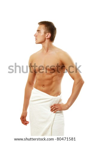 Wet muscular man wrapped a white towel isolated on white - stock photo