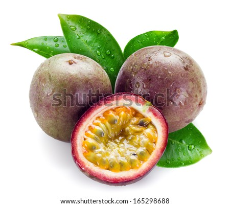 Wet passion fruits with leaves isolated on white - stock photo