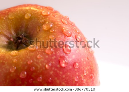 Wet red apple with water drops close up, macro