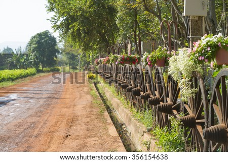 wet roads with Wagon Wheel Fence - stock photo