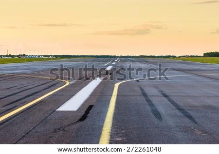 Wet Runway airport airplane strip plane asphalt road line - stock photo