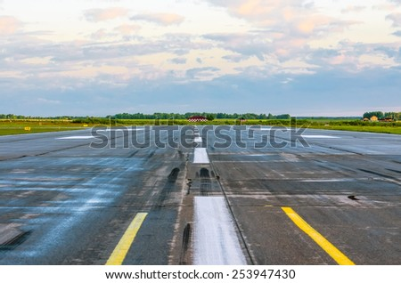 Wet Runway Airport strip plane asphalt road - stock photo