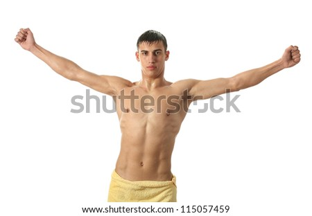 Wet sexy man wrapped in a yellow towel isolated on white